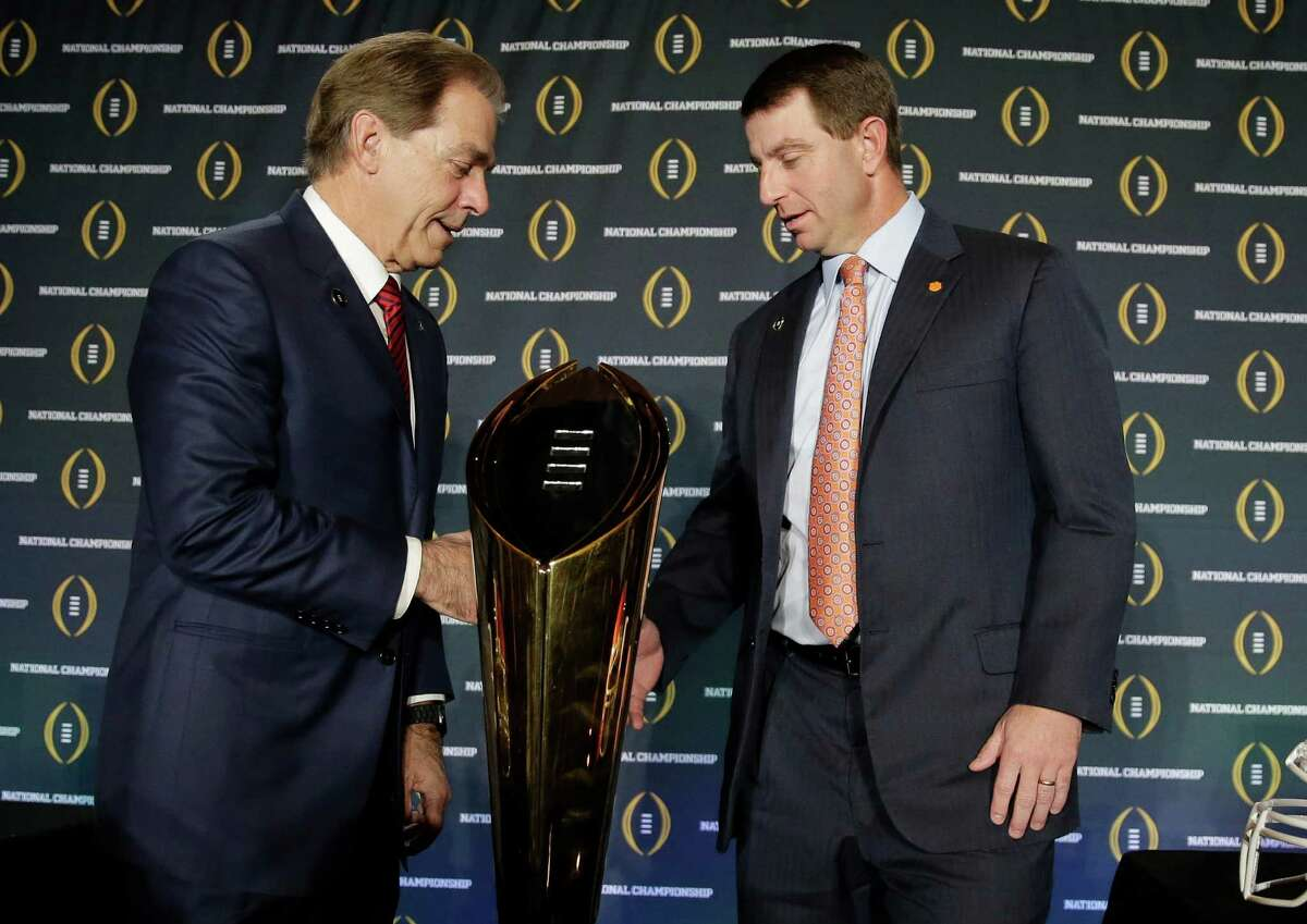 Clemson head coach Dabo Swinney and Alabama head coach Nick Saban shake hands after a news conference for the NCAA college football playoff championship game Sunday, Jan. 10, 2016, in Glendale, Ariz. (AP Photo/Chris Carlson) ORG XMIT: CFC130