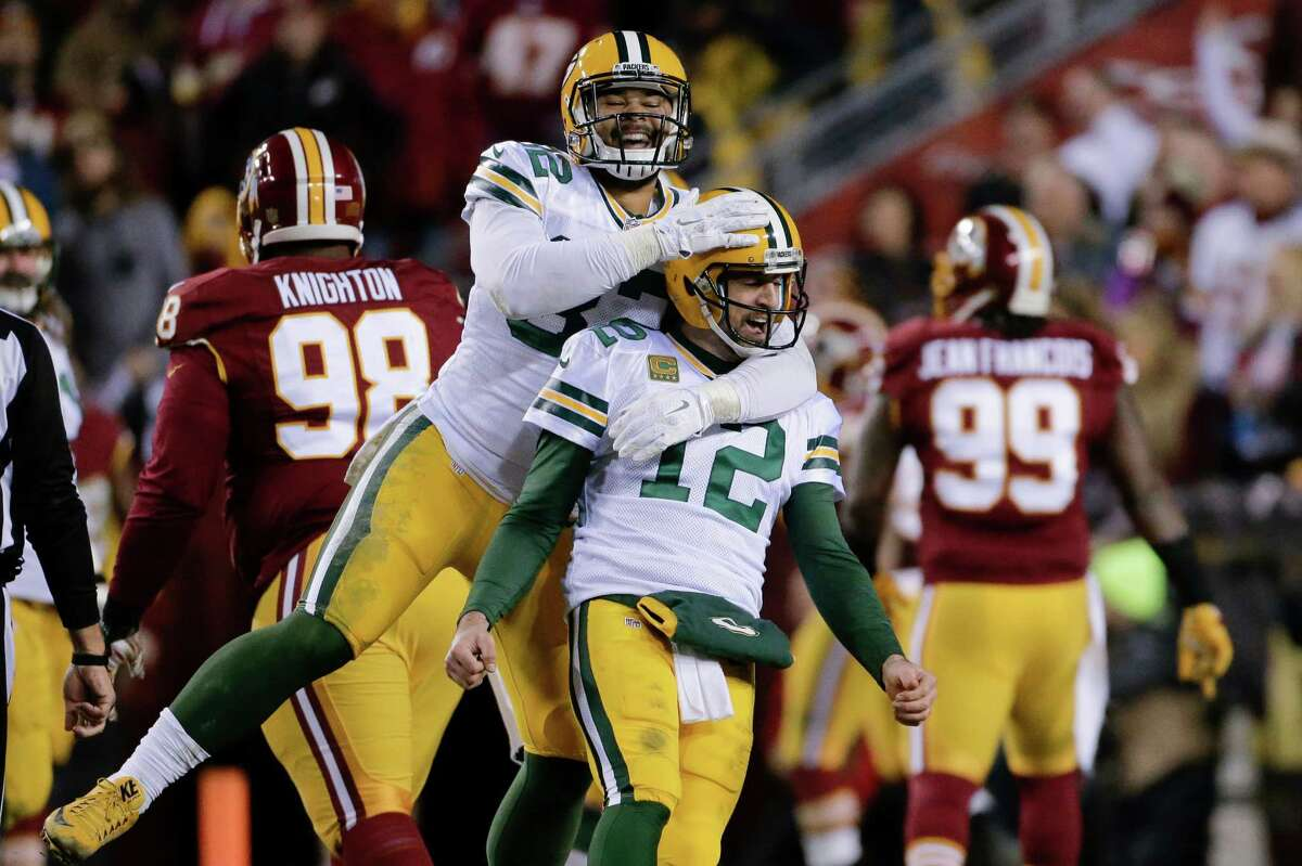 Green Bay Packers tight end Richard Rodgers (82) celebrates with quarterback Aaron Rodgers (12) after wide receiver Davante Adams caught a touchdown pass during the first half of an NFL wild-card playoff football game against the Washington Redskins in Landover, Md., Sunday, Jan. 10, 2016. (AP Photo/Mark Tenally) ORG XMIT: FDX117