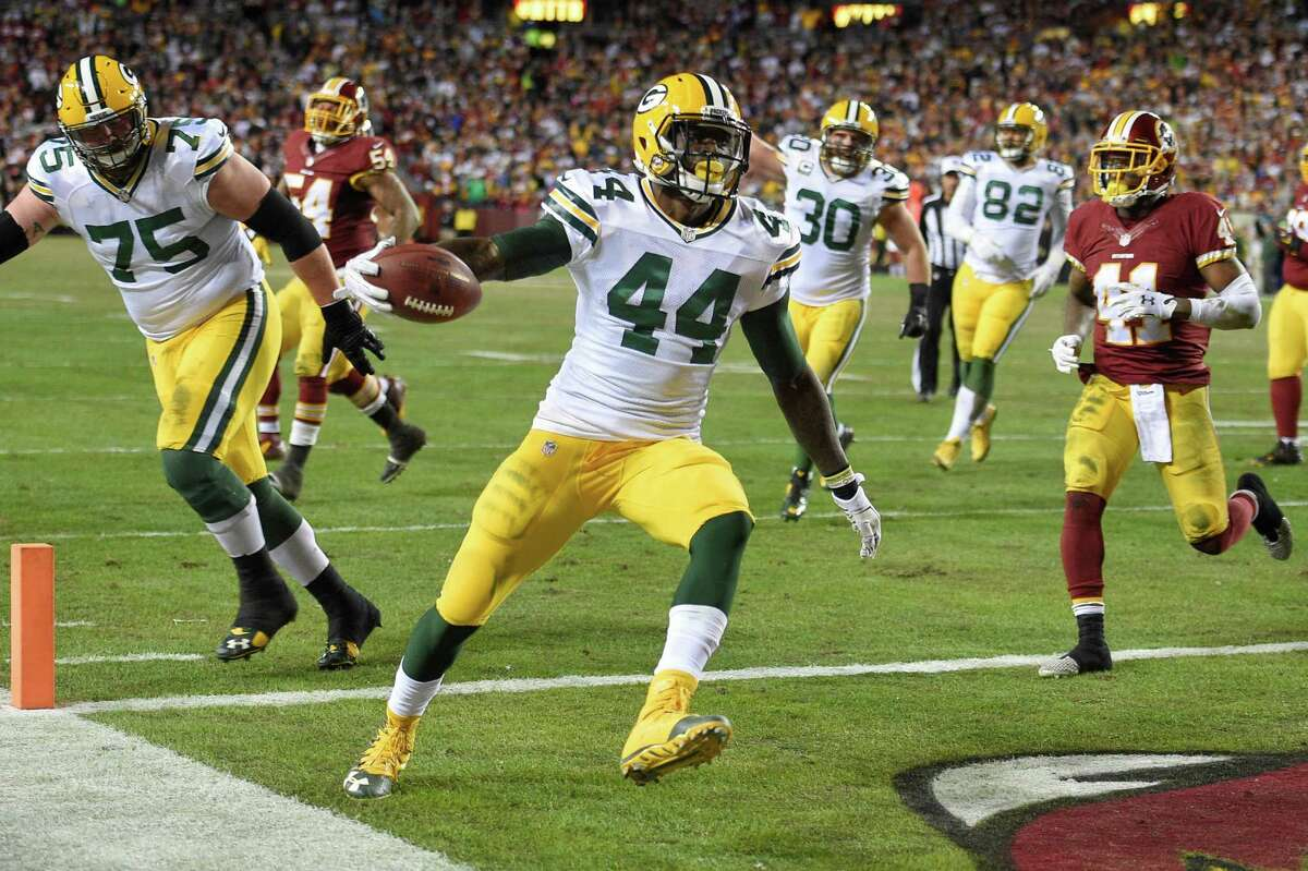 Green Bay Packers running back James Starks (44) carries the ball into the end zone for a touchdown as Washington Redskins cornerback Will Blackmon (41) watches during the second half of an NFL wild card playoff football game in Landover, Md., Sunday, Jan. 10, 2016. (AP Photo/Nick Wass) ORG XMIT: FDX120