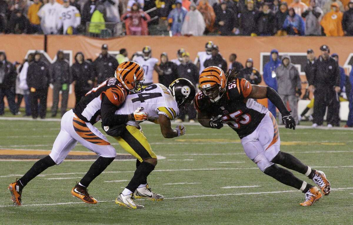 Cincinnati Bengals' Vontaze Burfict (55) runs into Pittsburgh Steelers' Antonio Brown (84) during the second half of an NFL wild-card playoff football game Sunday, Jan. 10, 2016, in Cincinnati. Pittsburgh won 18-16. Burfict was called for a penalty on the play. (AP Photo/John Minchillo) ORG XMIT: PBS163