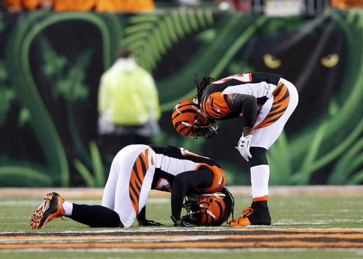 Cincinnati Bengals' Adam Jones (24) checks on Reggie Nelson after Nelson sacked Pittsburgh Steelers' Ben Roethlisberger during the first half of an NFL wild-card playoff football game Saturday, Jan. 9, 2016, in Cincinnati. (AP Photo/Frank Victores) ORG XMIT: PBS118