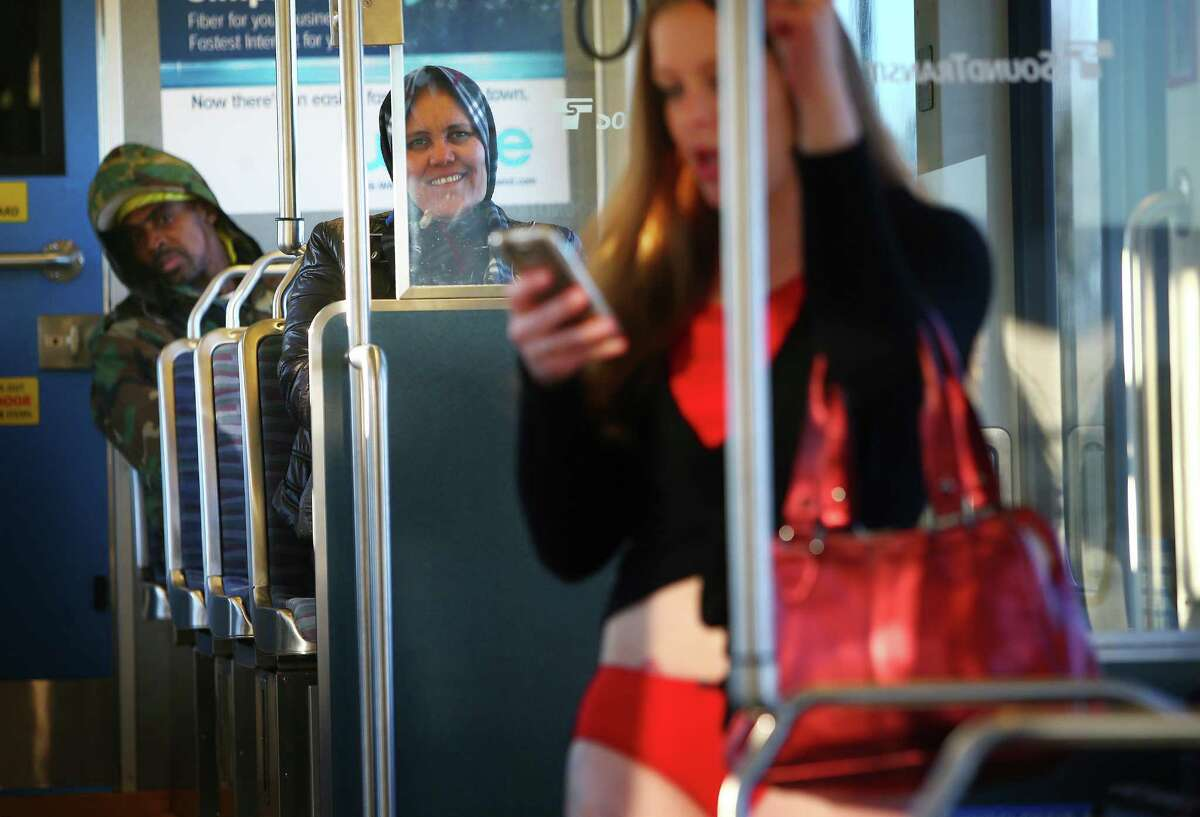 Other riders stare as participants ride pants-less during Seattle's annual No Pants Light Rail Ride from Westlake Center to Seattle-Tacoma International Airport, as if nothing is unusual. Photographed on Sunday, January 10, 2016.