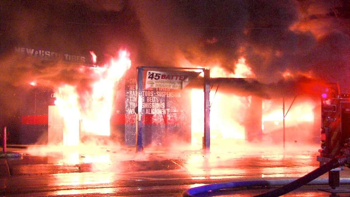 A fire erupted Sunday night at an auto shop on the Southeast Side.