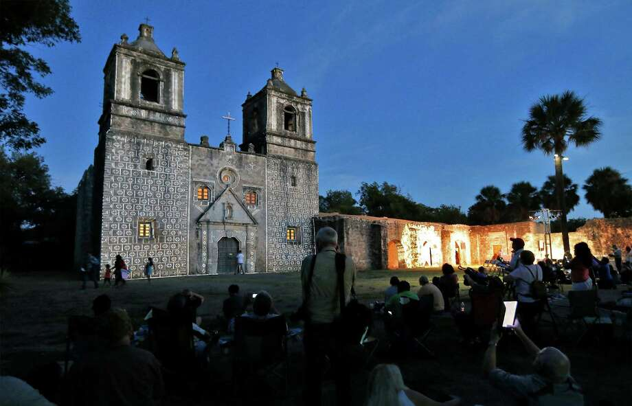 Mission Concepción just before sunset as guests await the actual light show as part of the World Heritage Site Celebrations in October. Viagran, the Catholic Archdiocese and surrounding neighbors support the redevelopment of an abandoned building near Mission Concepción. Photo: Kin Man Hui /San Antonio Express-News / ©2015 San Antonio Express-News