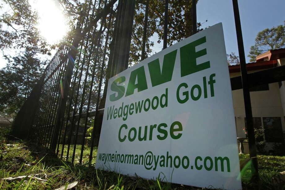 A sign is shown in a yard along the Wedgewood Golf Course, 5454 TX-105, Tuesday, Dec. 8, 2015, in Conroe. The course which has been around some 30 years, but is now about to close. Some residents of the area want to buy it and keep it as a golf course. Otherwise, the bank could sell it to developers and the homeowners worry that would cause them to lose value on their homes. ( Melissa Phillip  / Houston Chronicle ) Photo: Melissa Phillip, Staff / © 2015 Houston Chronicle