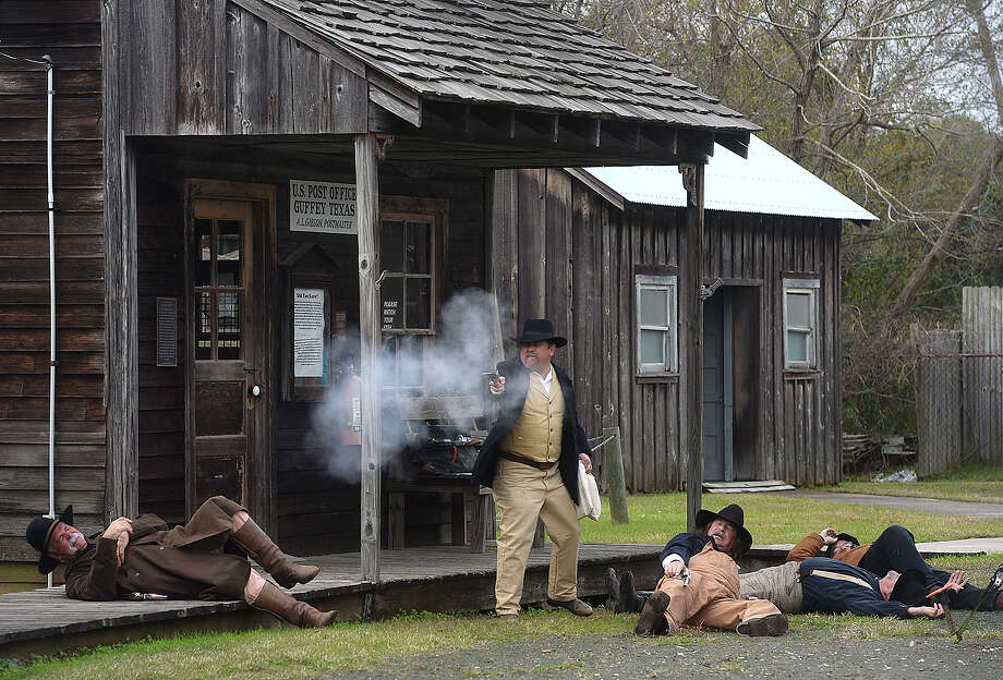 "A shoot-out unfolds during a robbery skit at the ""Driller's Reunion"" celebrating the 115th anniversary of Spindletop at the Spindletop-Gladys City Boomtown Museum Saturday. The day-long event featured demonstrations of life during the oil boom, shoot-outs, tea times, a period fashion show, and was capped off with the blowing of the gusher.  Photo taken Saturday, January 9, 2016  Kim Brent/The Enterprise Photo: Kim Brent / Beaumont Enterprise"