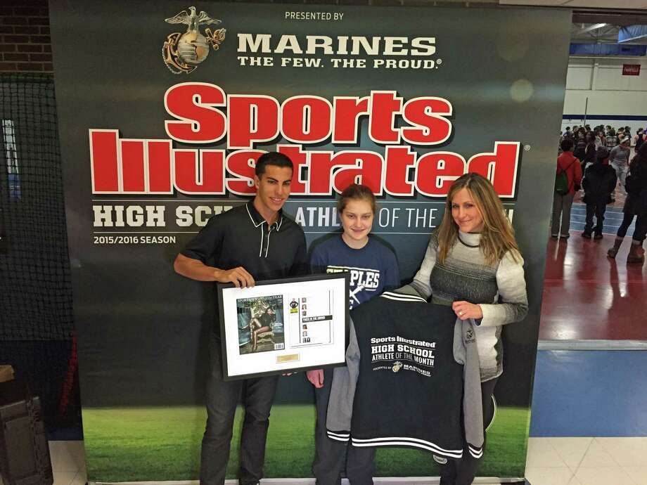 Donn Cabral, celebrity athlete and 2012 steeplechase Olympian, Staples' Hannah DeBalsi and DeBalsi's mother, Sara Bassett pose with the Sports Illustrated High School Athlete of the Month award and embroidered jacket on Saturday in Westport. Photo: Sports Illustrated / Stamford Advocate Contributed