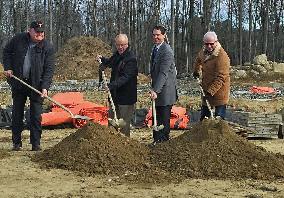 From left, Charles Mallory, Greenwich Hospitality; Mayor Mark Boughton; Randy Salvatore, RMS Companies; Ramze Zakka, Z Hospitality. Photo: / Contributed Photo