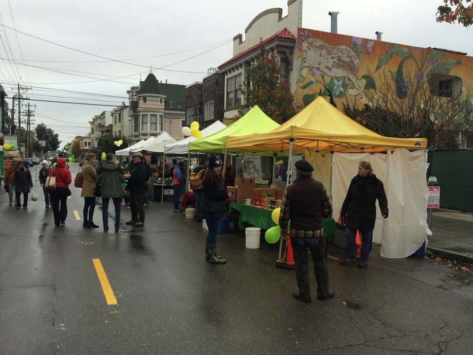 Shoppers browsed produce booths at the temporary location of the Noe Valley Farmers' Market on 24th Street between Sanchez and Vicksburg Streets on Jan. 10, 2016. Photo: Amy Graff