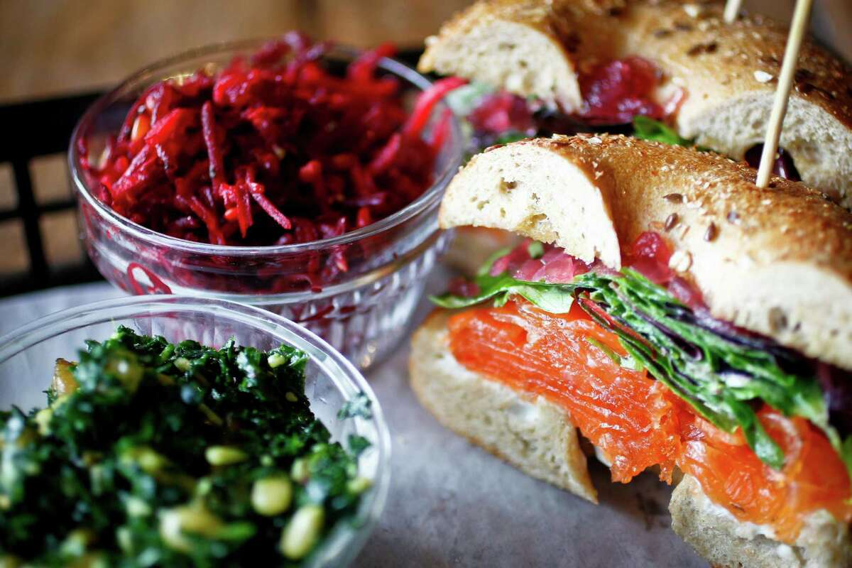 The House Smoked Salmon Sandwich, with local greens, onion jam, poppy bagel, served with two sides: Beets and Tuscan Kale at Local Foods a new restaurant in Rice Village and owned by Benjy's owner Benjy Levit, Thursday, Jan. 5, 2012, in Houston. The store sells take-away meals and prepared foods; local artisan foods; and sit-down meals.