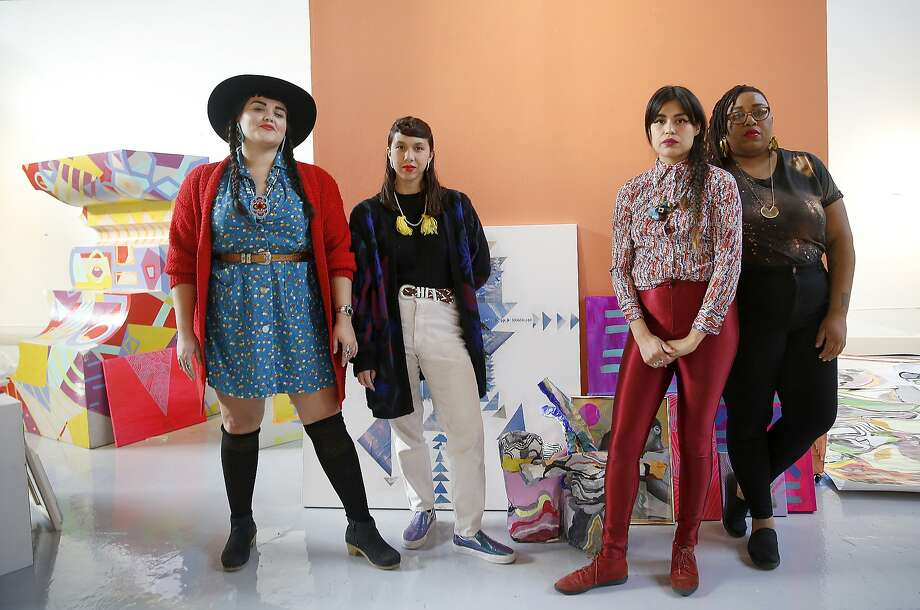 Founders and artists of Black Salt, a women's artist collective,  left to right--Sarah Biscarra Dilley, and Anna Luisa Petrisko (Jeepneys), Grace Rosario Perkins,  and Adee Roberson work on their show at SOMArts in San Francisco, California, on Friday,  January 8, 2015. Photo: Liz Hafalia, The Chronicle