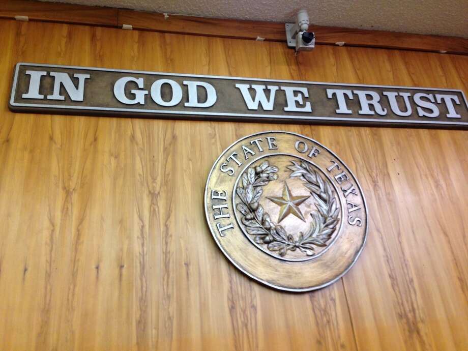 "Hardin County Judge Wayne McDaniel on Monday unveiled a plaque hanging in the commissioners' courtroom that reads: ""In God We Trust."" Commissioners unanimously approved displaying the motto in February of last year. Photo: Eric Besson"