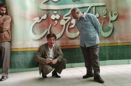 Oscar-winning American actor Sean Penn works as a journalist for The San Francisco Chronicle during Friday prayers June 10, 2005 in Tehran, Iran. Under the shadow of US suspicion that Iran aims to build nuclear weapons, Iranians are preparing to elect a new president on June 17.