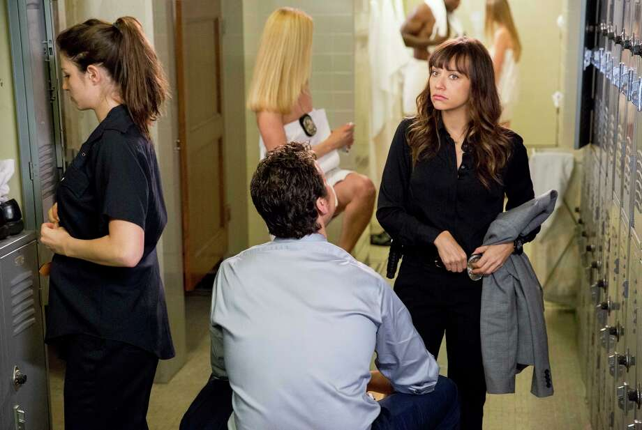 In the title role, Los Angeles detective Angie Tribeca (Rashida Jones) talks to new partner Jay Geils (Hayes MacArthur). Photo: Tyler Golden / ™ & © Turner Entertainment Networks, Inc. A Time Warner Company. All Rights Reserved.