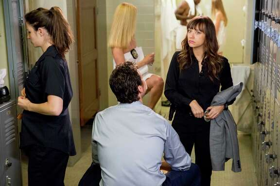 In the title role, Los Angeles detective Angie Tribeca (Rashida Jones) talks to new partner Jay Geils (Hayes MacArthur).