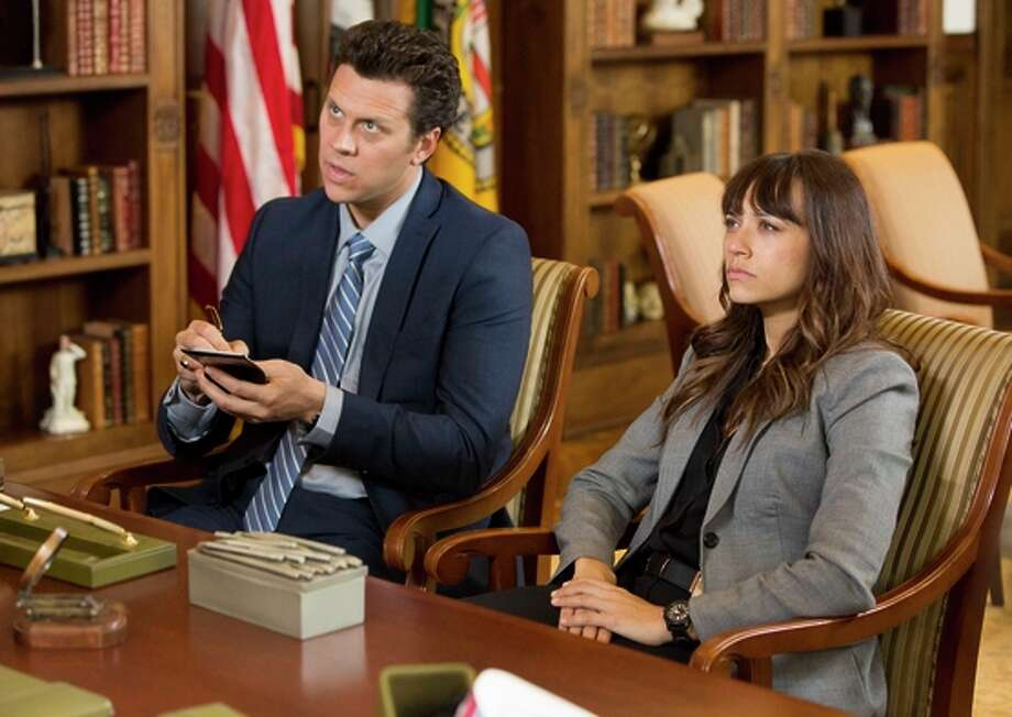 "Hayes MacArthur and Rashida Jones as LAPD detectives in ""Angie Tribeca."" Photo: Tyler Golden / ™ & © Turner Entertainment Networks, Inc. A Time Warner Company. All Rights Reserved."