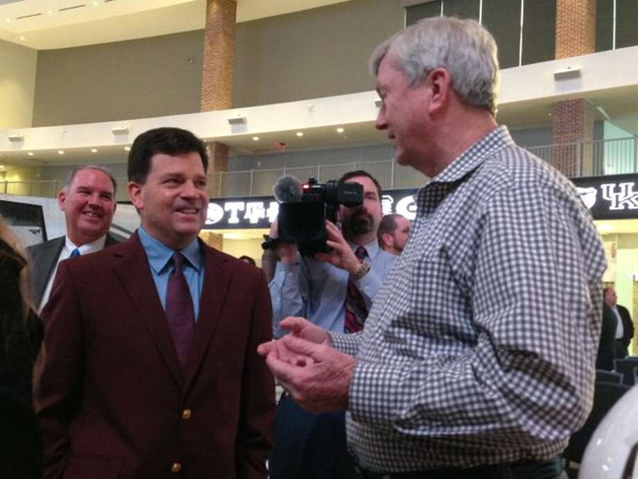New Texas A&M athletic director Scott Woodward (left) visits with women's basketball coach Gary Blair, who led the Aggies to the 2011 national title. (Brent Zwerneman / Houston Chronicle)