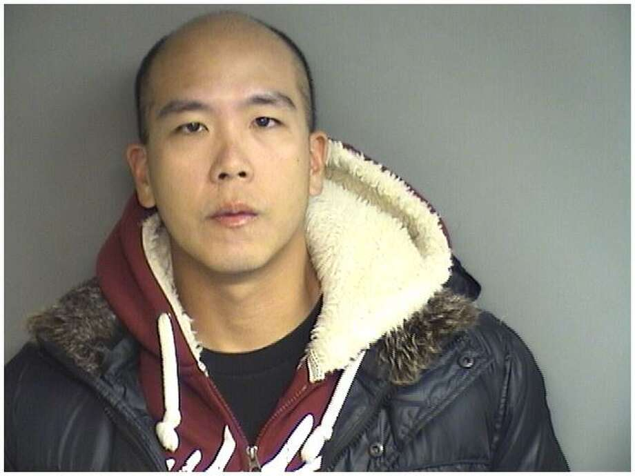 Donald Chen, 30, of Queens, New York, pleaded guilty to first-degree larceny for allegedly taking his police pay when he was supposed to be with the US Army Reserves, but enjoying a Hawaiian holiday with his girlfriend instead. Photo: Stamford Police Department / Contributed Photo / Stamford Advocate Contributed
