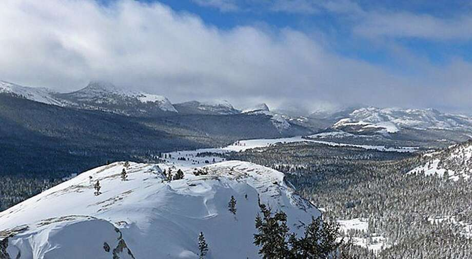 The 9,449-foot Lembert Dome, with Tuolumne Meadows in the background, where 24 inches of snow last week has compressed and brought the snowpack here up to 4 feet across the high country for miles, with higher amounts on wind-driven slabs. Photo: Laura Pilewski, National Park Service
