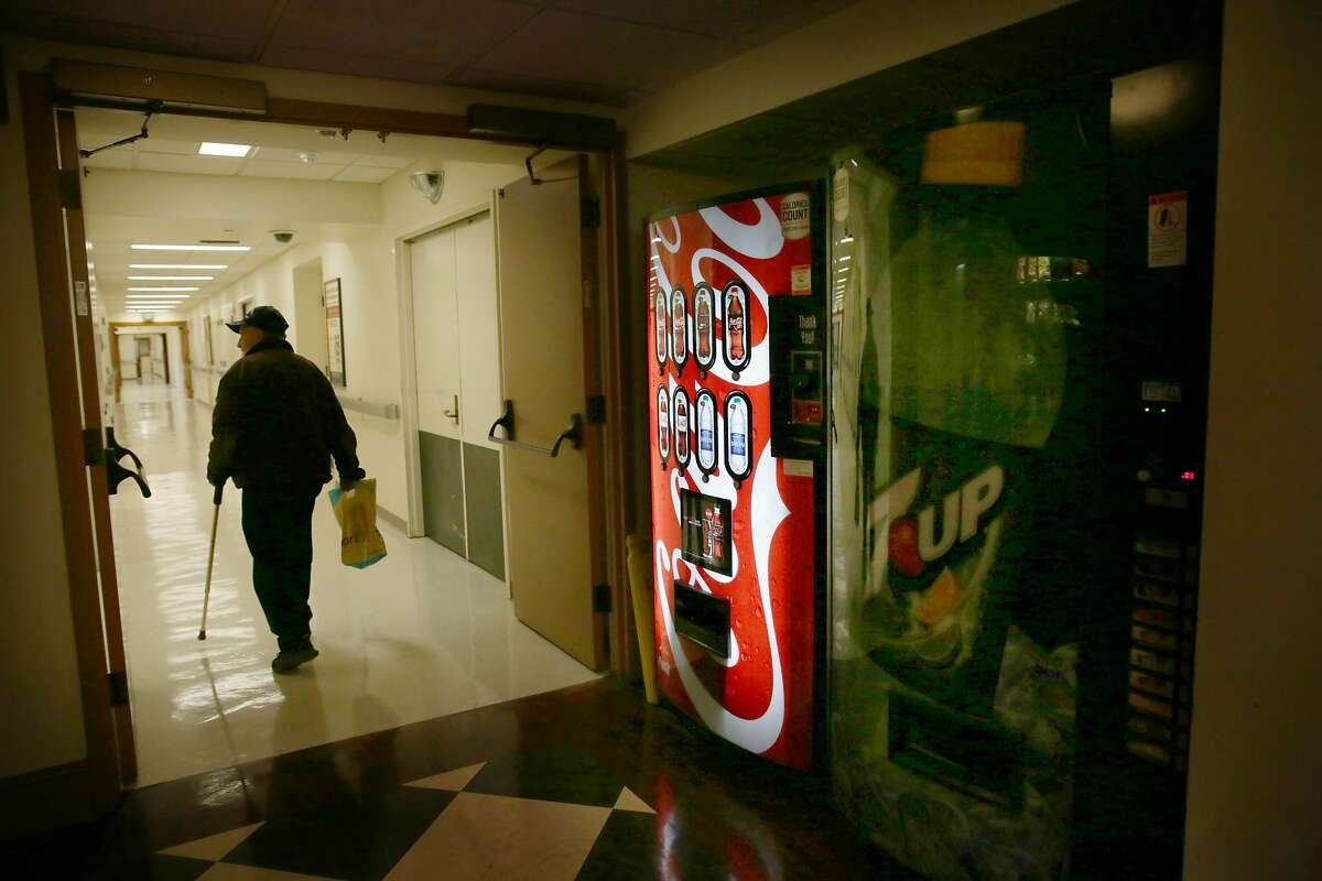Joe Rubi walks past vending machines near the cafe in the basement of City Hall on Monday, January 11, 2015 in San Francisco, Calif.