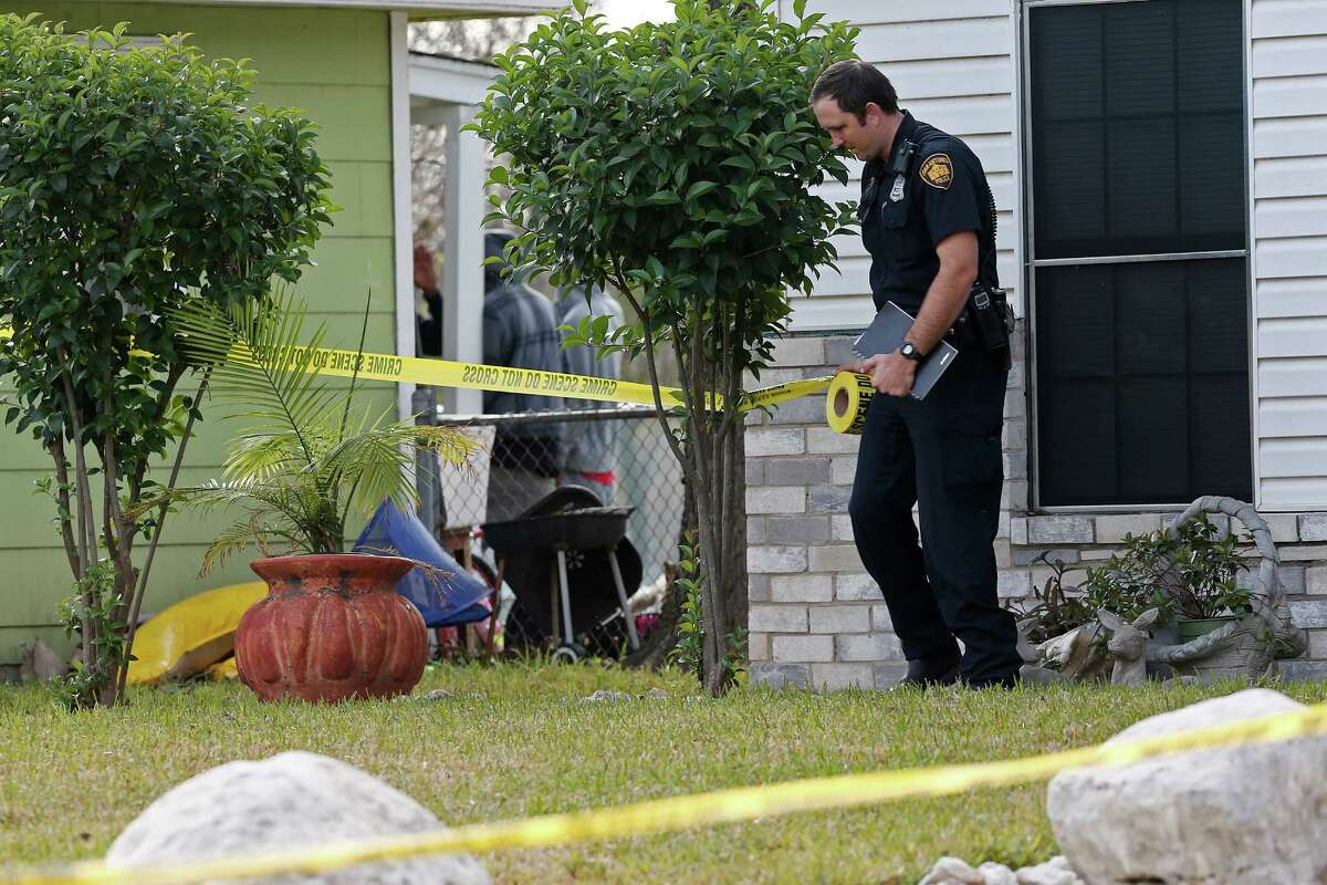 San Antonio Police personnel investigate the scene of a motor vehicle crash that left a man in his 20's dead at the 700 block of Upland Road, Monday, Jan. 11, 2016. Another person in the vehicle was taken to a local hospital in unknown condition. The vehicle was involved in a rolling shootout with another vehicle when the driver lost control and crashed into a tree of a residence along the road. SAPD hasn't located the second vehicle involved.