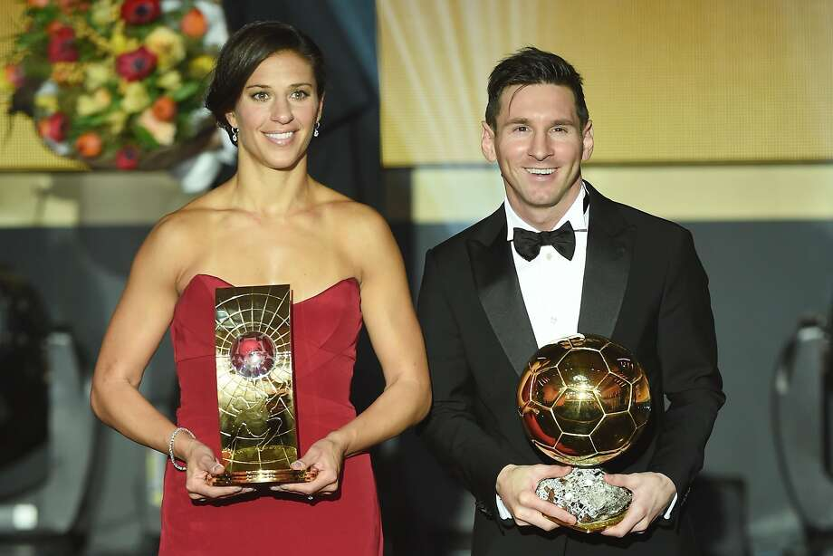 ZURICH, SWITZERLAND - JANUARY 11:  Carli Lloyd of USA and Houston Dash the recipient of the FIFA Women's World Player of the Year Award and Lionel Messi of Argentina and FC Barcelona recipient of the Ballon d'or pose during the FIFA Ballon d'Or Gala 2015 at the Kongresshaus on January 11, 2016 in Zurich, Switzerland.  (Photo by Matthias Hangst/Getty Images) Photo: Matthias Hangst, Getty Images