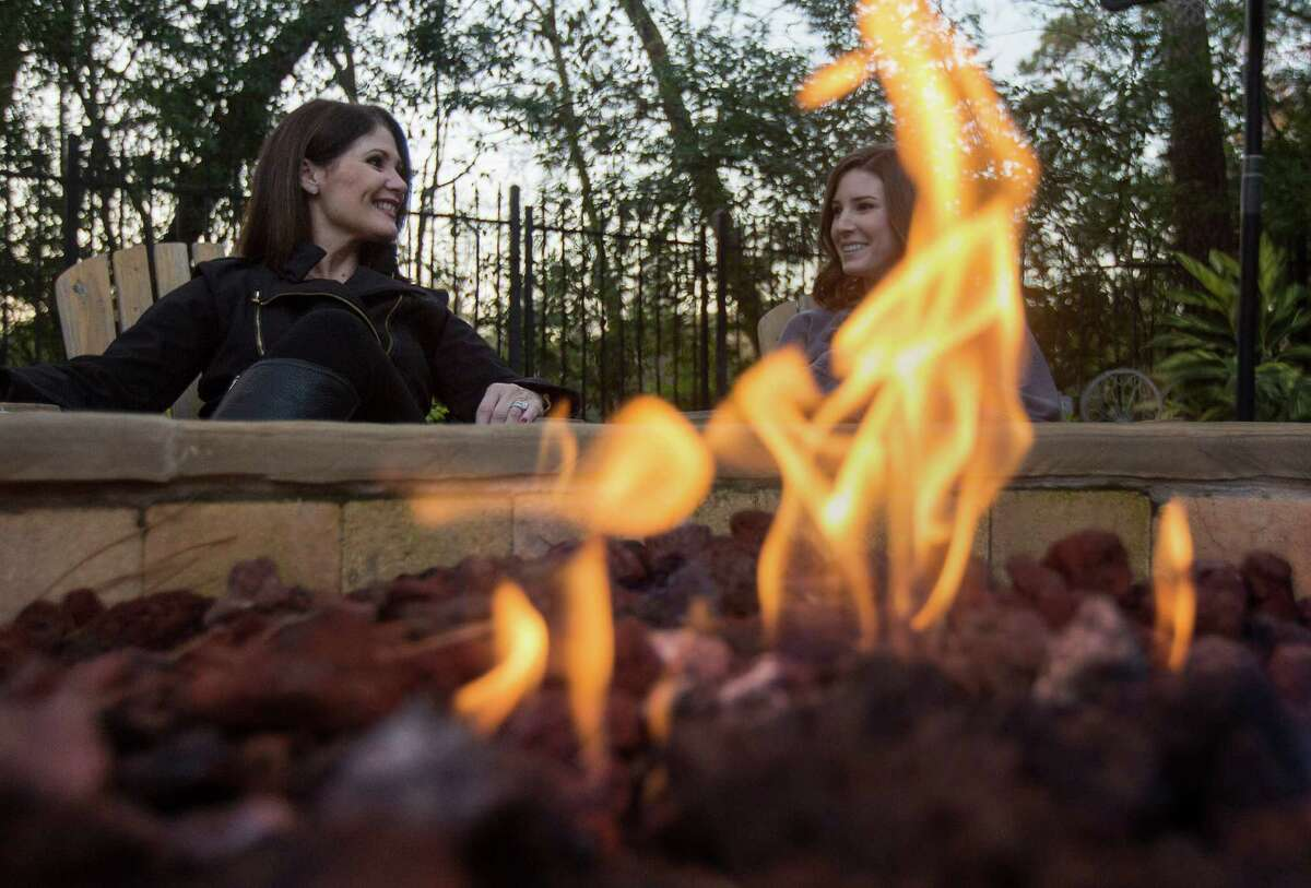 Vickie Staff, left, sits with her daughter Stephanie Dishman, next to her custom-built fire pit in her backyard, Thursday, Jan. 7, 2016, in Houston. ( Jon Shapley / Houston Chronicle )
