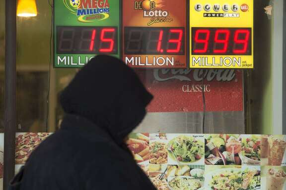 A woman walks past a sign showing a Powerball prize of $999 million, the largest jackpot winnings that the Powerball sign can display, with the actual Powerball jackpot estimated at $1.3 billion, outside a deli in Washington, DC, January 11, 2016. The jackpot for the US Powerball lottery rose to a whopping $1.3 billion (1.19 billion euros) on January 10, by far the largest in US history, after organizers said there was no winner in the weekend draw. The Powerball prize rocketed to $950 million on Saturday, fueling a frenzy of lotto ticket buying across the United States. Numbers were drawn and announced late Saturday at 10:59 pm (0359 GMT Sunday) -- but hours later lottery officials said there was no winner. AFP PHOTO / SAUL LOEBSAUL LOEB/AFP/Getty Images