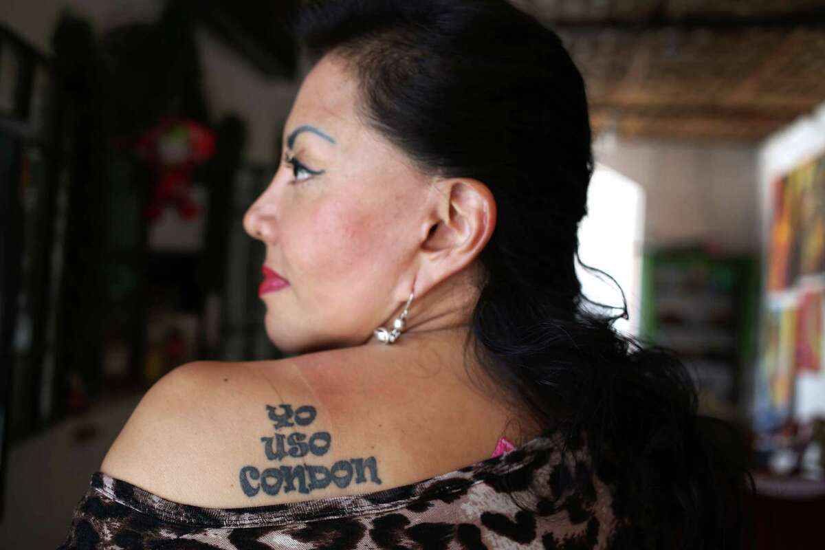 In this Jan. 5, 2016 photo, Angela Villon, a 51-year-old prostitute, activist and congressional candidate shows her tattoo on her shoulder, that reads in Spanish