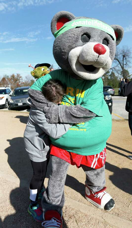 "Rockets mascot, Clutch, hugs Sarah Pepper, the Hot 95.7 morning show host and the Aramco Houston Half Marathon Ambassador during the Houston Marathon Committee's annual ""Why I Run"" media day at Memorial Park on Monday, Jan. 11, 2016, in Houston. Photo: Karen Warren, Houston Chronicle / © 2015  Houston Chronicle"