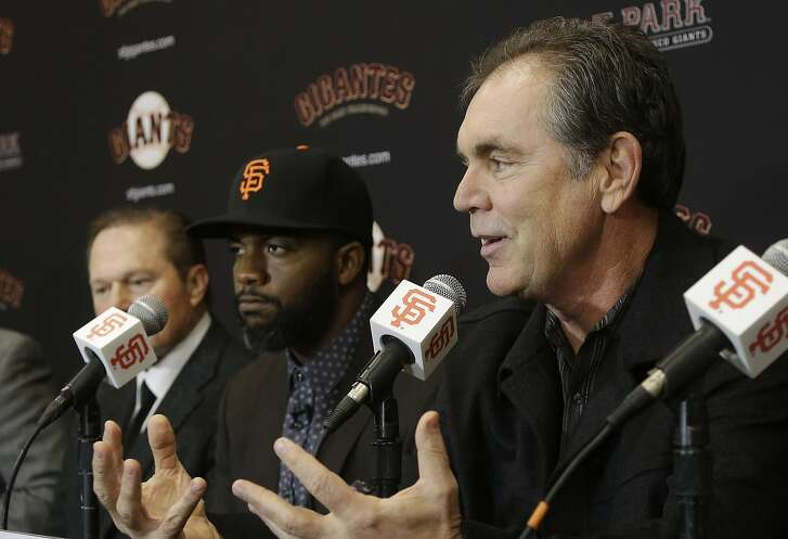 San Francisco Giants manager Bruce Bochy, right, speaks next to outfielder Denard Span, center, and agent Scott Boras at a news conference in San Francisco, Friday, Jan. 8, 2016. The Giants agreed on a $31 million, three-year deal with free agent Span, giving them the outfielder and leadoff hitter they had sought. (AP Photo/Jeff Chiu)