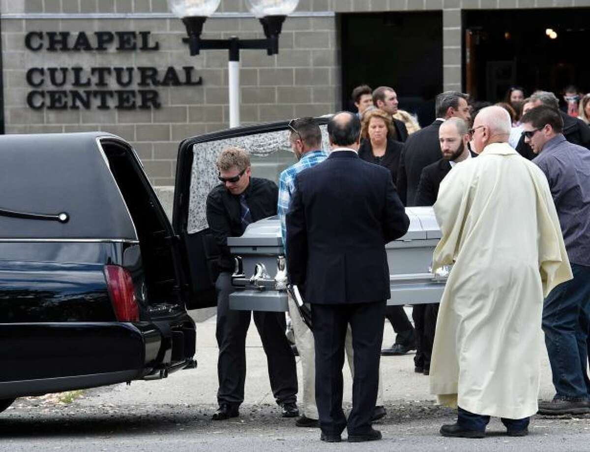 The casket of Brendon Glenn is moved from the Rensselaer Polytechnic Institute Cultural Center following the funeral ceremony Wednesday afternoon, May 20, 2015, in Troy, N.Y. (Skip Dickstein/Times Union archive)