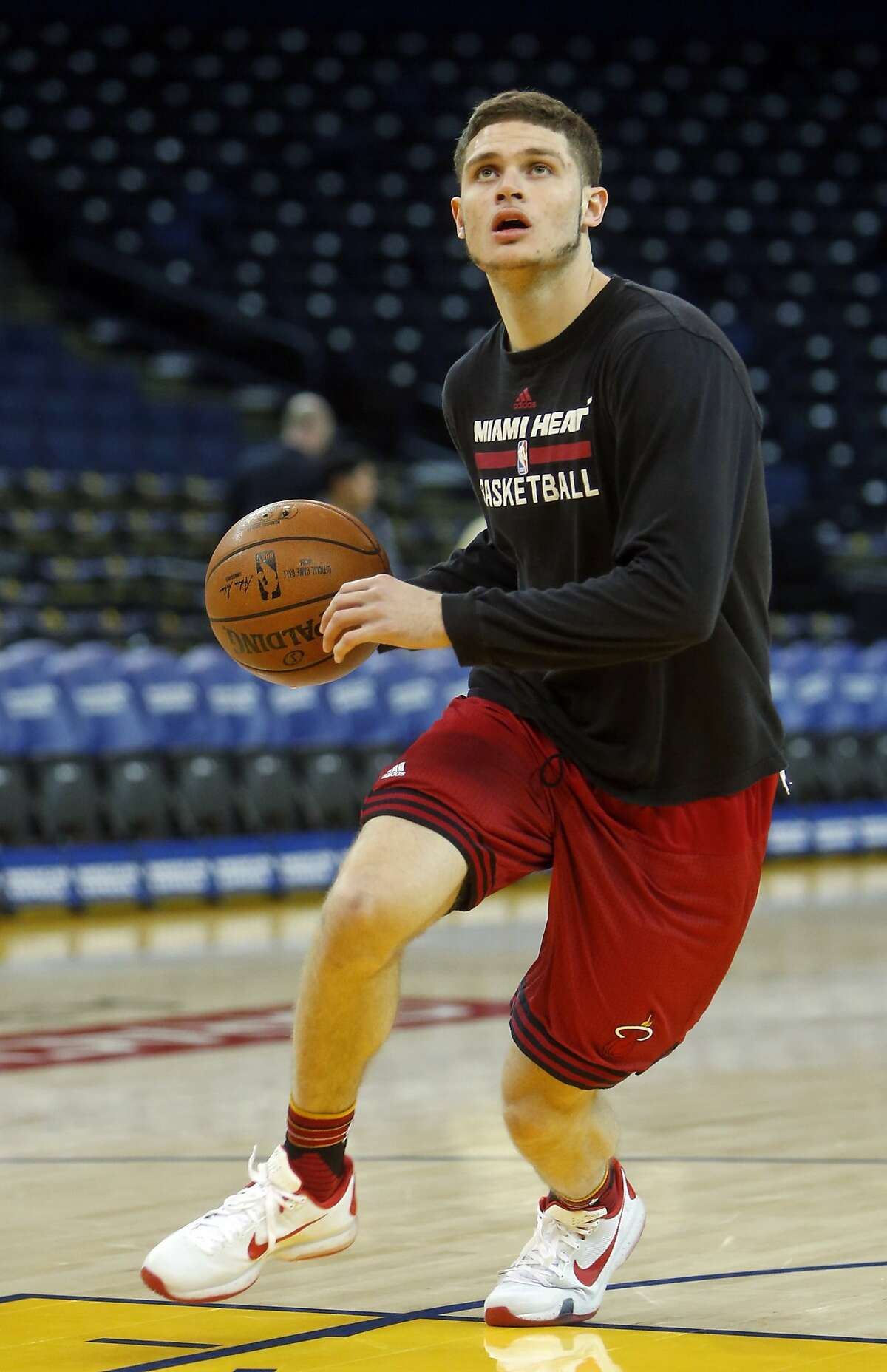 Miami Heat's Tyler Johnson warms up before NBA game against Golden State Warriors at Oracle Arena in Oakland, Calif., on Monday, January 11, 2016.