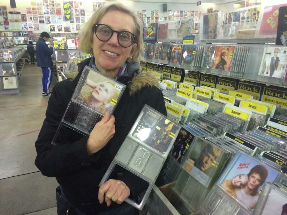 Devon Warner finds a copy of Hunky Dory, the first David Bowie album she purchased as a kid, and Ziggy Stardust, her favorite Bowie album, at Amoeba Music on Haight Street in San Francisco on Jan. 11, 2016, the day after the musician passed away. Photo: Amy Graff