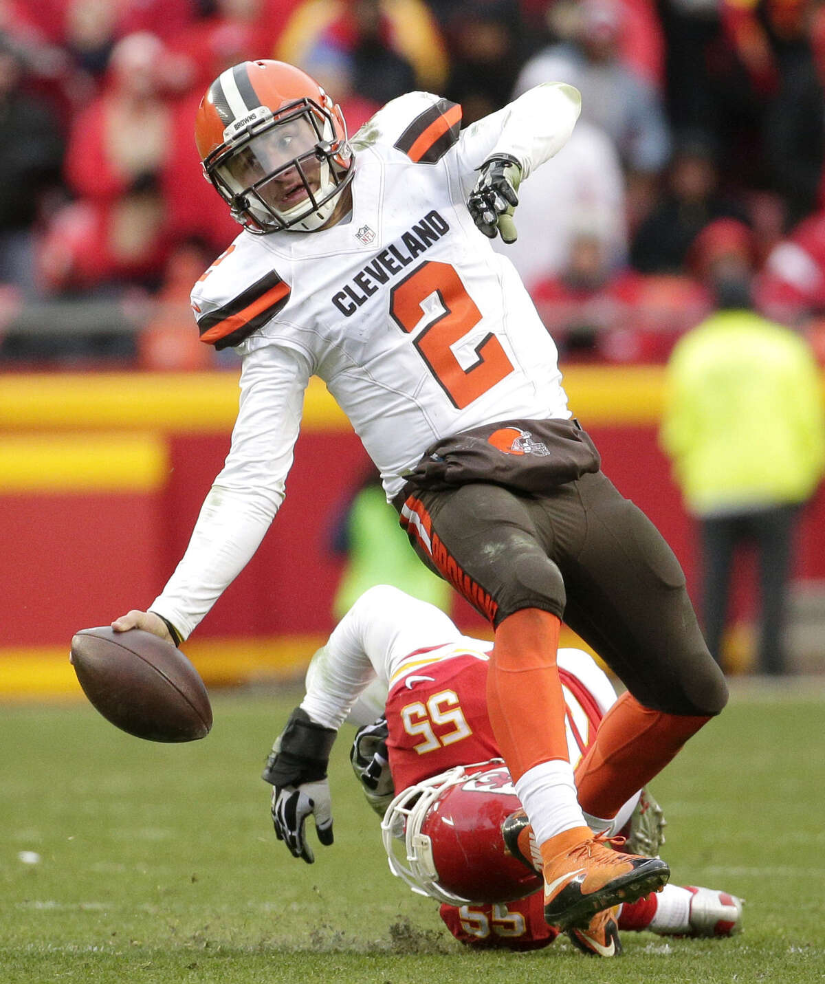 Cleveland Browns quarterback Johnny Manziel (2) is tackled by Kansas City Chiefs linebacker Dee Ford (55) during the second half of an NFL football game in Kansas City, Mo., Sunday, Dec. 27, 2015. (AP Photo/Charlie Riedel)