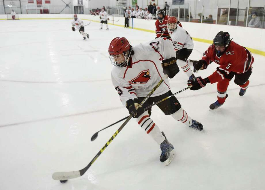 Greenwich's Owen Johnson (3) moves past New Canaan's Benjamin Webster (5) near the goal in Greenwich's 6-3 win over New Canaan in the high school boys ice hockey game at Dorothy Hamill Skating Rink in Greenwich, Conn. Monday, Jan. 11, 2016. Photo: Tyler Sizemore / Hearst Connecticut Media / Greenwich Time