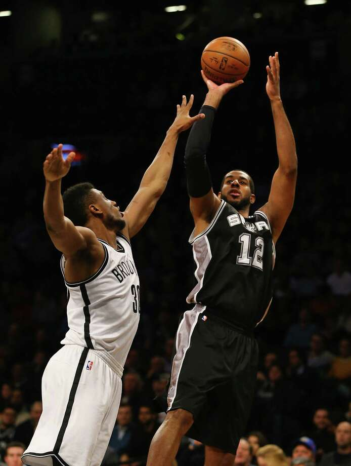 NEW YORK, NY - JANUARY 11:  LaMarcus Aldridge #12 of the San Antonio Spurs shoots against Thaddeus Young #30 of the Brooklyn Nets during their game at the Barclays Center on January 11, 2016 in New York City.  NOTE TO USER: User expressly acknowledges and agrees that, by downloading and/or using this Photograph, user is consenting to the terms and conditions of the Getty Images License Agreement. Photo: Al Bello, Getty Images / 2016 Getty Images