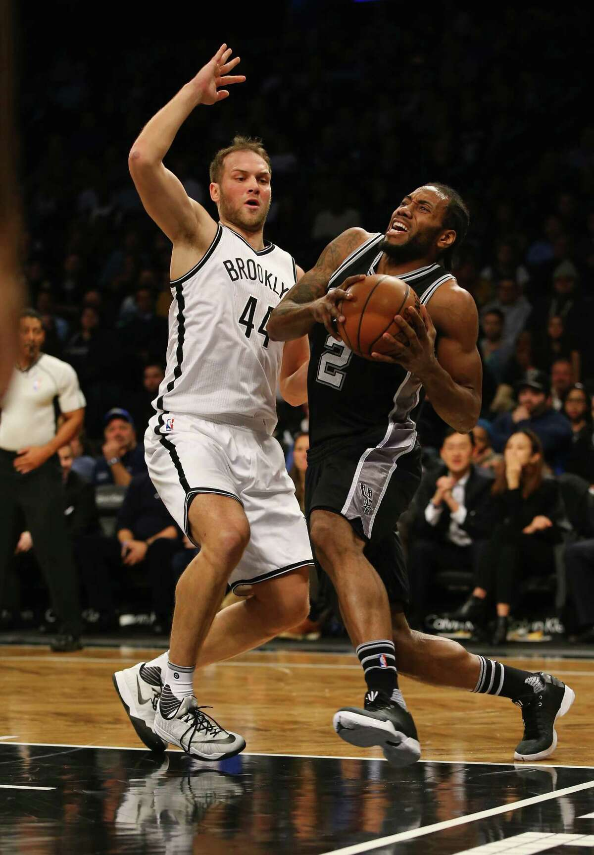 NEW YORK, NY - JANUARY 11: Kawhi Leonard #2 of the San Antonio Spurs drives against Bojan Bogdanovic #44 of the Brooklyn Nets during their game at the Barclays Center on January 11, 2016 in New York City. NOTE TO USER: User expressly acknowledges and agrees that, by downloading and/or using this Photograph, user is consenting to the terms and conditions of the Getty Images License Agreement.