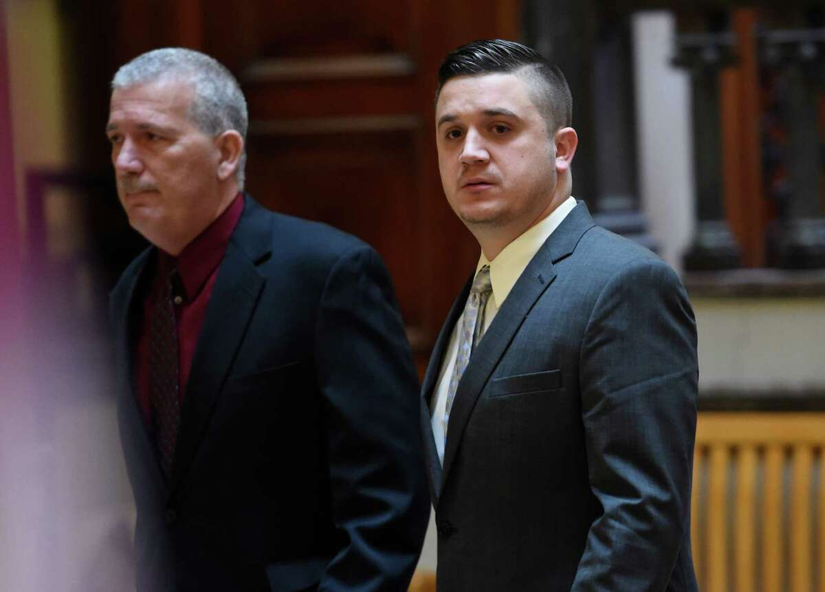 Nicholas Pontore, right, the 30-year-old former Watervliet cops accused of protecting a gang-related narcotics ring and buying cocaine while on the job, arrives at the Rensselaer County Courthouse Monday, Jan. 11, 2016, in Troy, N.Y. Pontore took a plea deal and was taken to jail after a conviction on 4th degree possession of a controlled substance. (Skip Dickstein/Times Union)