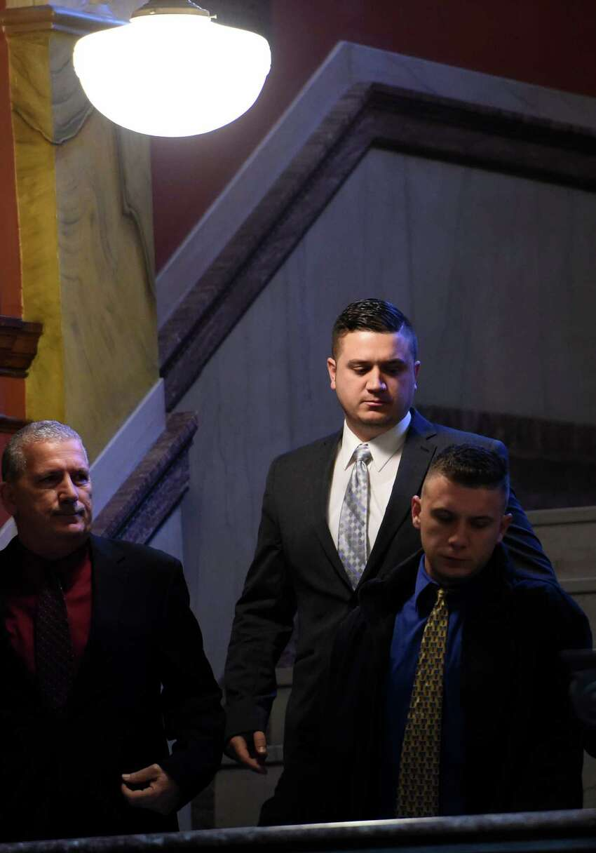 Nicholas Pontore, center, the 30-year-old former Watervliet cops accused of protecting a gang-related narcotics ring and buying cocaine while on the job, arrives at the Rensselaer County Courthouse Monday, Jan. 11, 2016, in Troy, N.Y. Pontore took a plea deal and was taken to jail after a conviction on 4th degree possession of a controlled substance. (Skip Dickstein/Times Union)