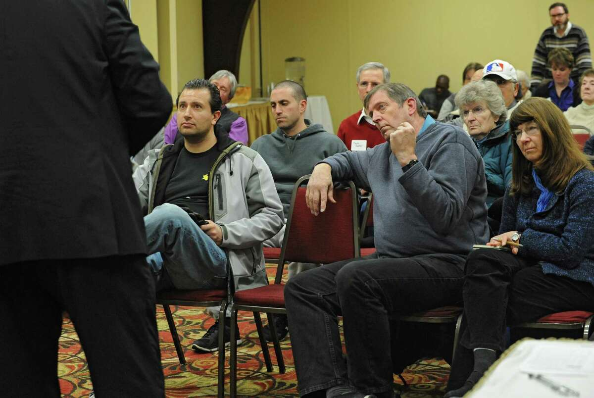 James Van Voorst, of The University At Albany, left, answers a questions as neighbors of the University at Albany attend a meeting at the Best Western on Western Ave. on Monday, Jan. 11, 2016 in Albany, N.Y. Representatives of UAlbany wanted to answer questions about the nearly nine wooded acres off Norwood Street and Waverly Place they recently purchased. (Lori Van Buren / Times Union)