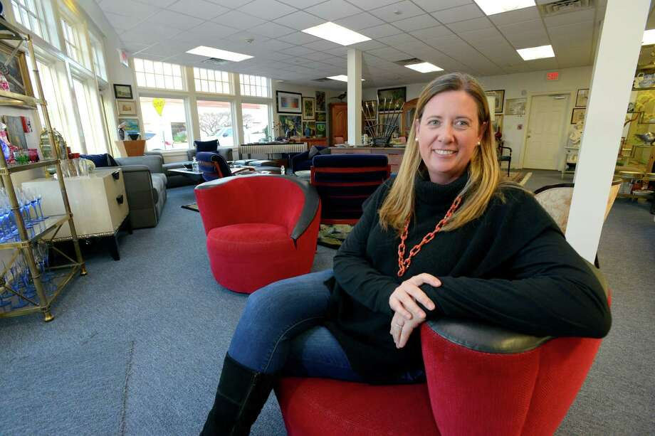 Christie Spooner, owner and founder of Black Rock Galleries, sits in the showroom of their newly opened Greenwich store front (pictured left). Black Rock Galleries based in Bridgeport, known for their innovative web base auctions, is New Englands largest based auction house and consignment showroom. Photo: Matthew Brown / Hearst Connecticut Media / Stamford Advocate