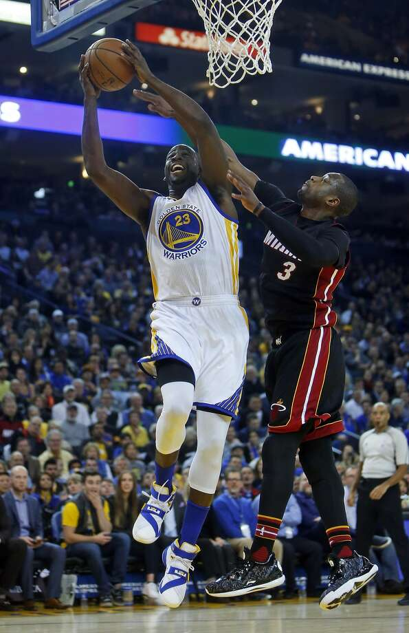 Golden State Warriors' Draymond Green scores against Miami Heat's Dwyane Wade in 1st quarter during NBA game at Oracle Arena in Oakland, Calif., on Monday, January 11, 2016. Photo: Scott Strazzante, The Chronicle
