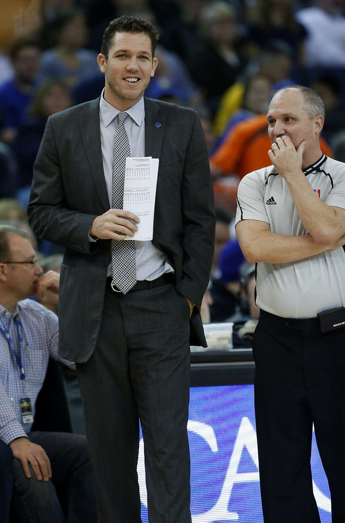 Golden State Warriors' interim coach Luke Walton jokes with an official in 1st quarter against Miami Heat during NBA game at Oracle Arena in Oakland, Calif., on Monday, January 11, 2016.