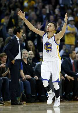 Golden State Warriors' Stephen Curry celebrates 3-pointer against Miami Heat in 4th quarter of Warriors' 111-103 win in NBA game at Oracle Arena in Oakland, Calif., on Monday, January 11, 2016.
