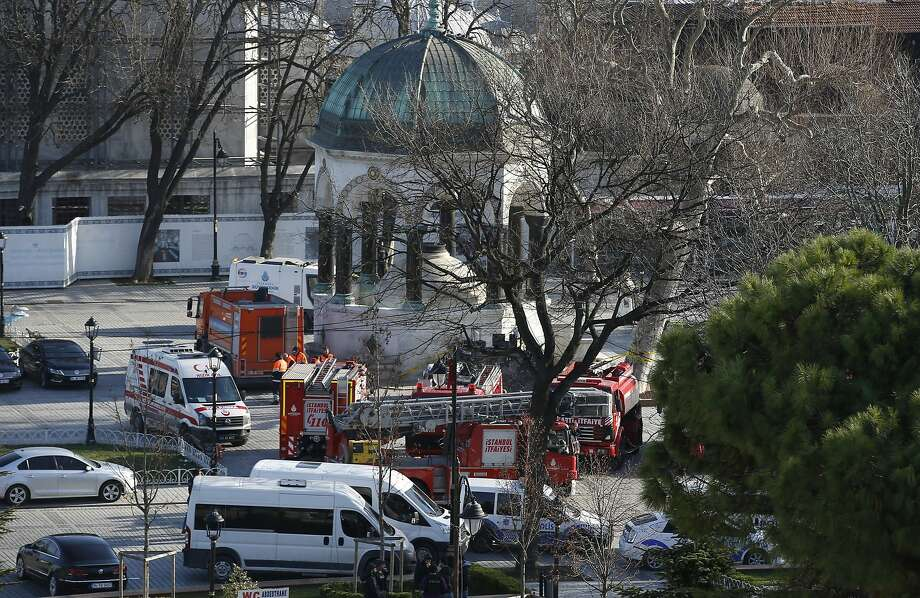 Rescue vehicles are parked at the site of an explosion in the historic district popular with foreigners. Photo: Emrah Gurel, Associated Press