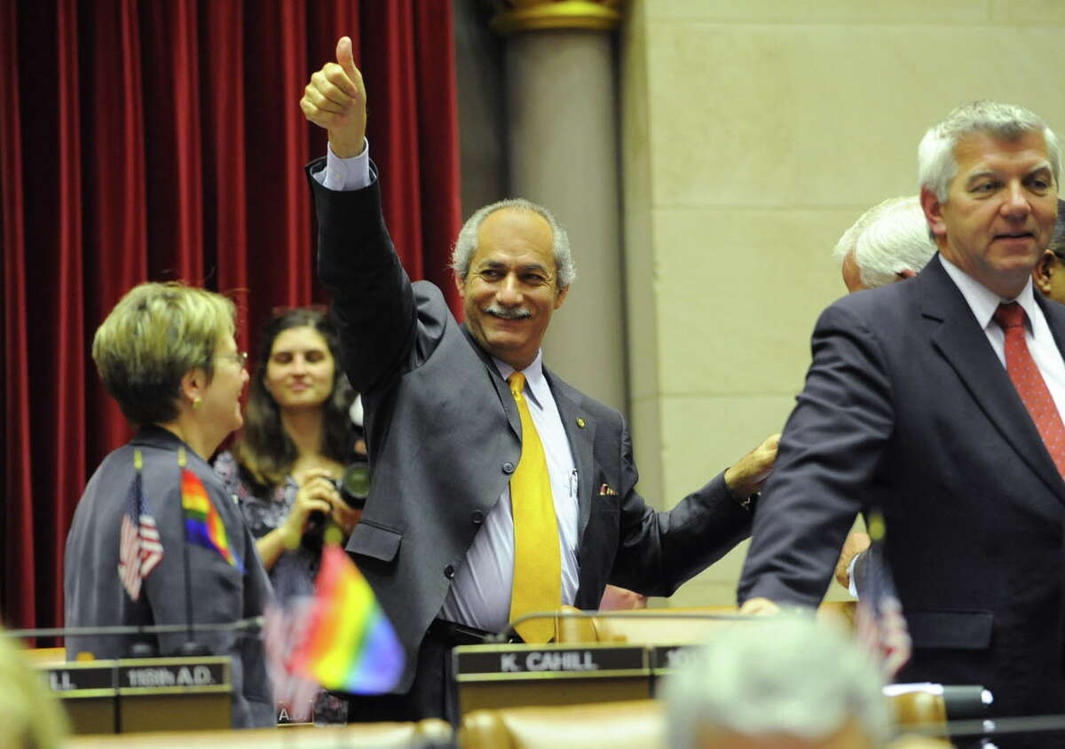 Assemblyman Guillermo Linares gives the thumbs up after hugging Assemblywoman Deborah Glick, left, after the marriage equality act passes in the assembly chamber at the Capitol in Albany, N.Y. Wednesday June 15, 2011. (Lori Van Buren / Times Union)