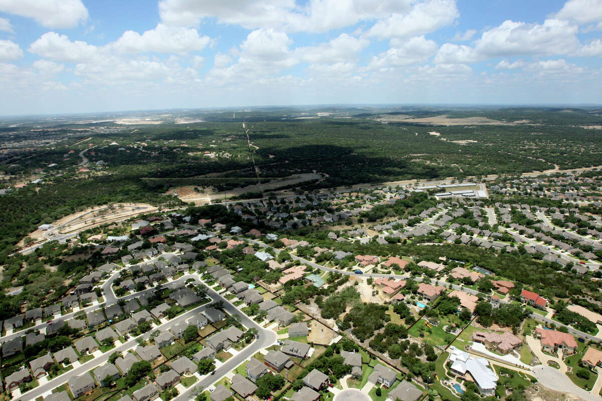 This aerial photo shows developments east (bottom) and south (L) of Camp Bullis with a portion of Camp Bullis visible in the upper right.