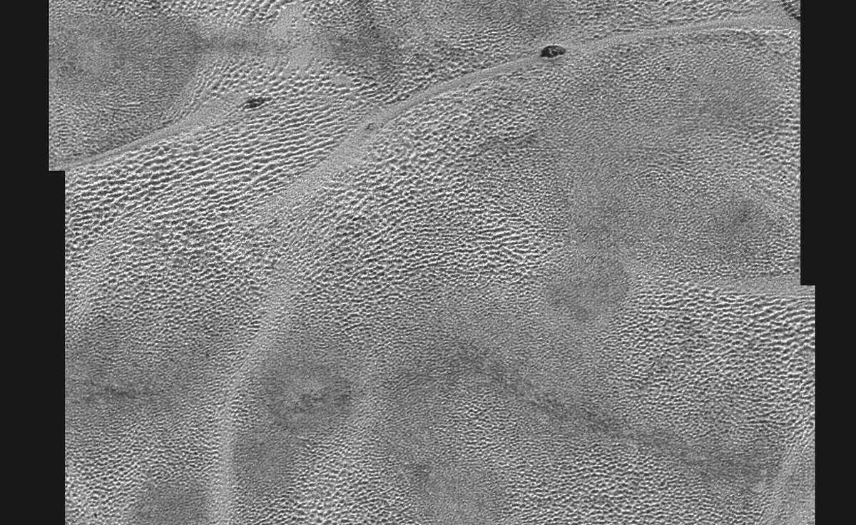 Since NASA's New Horizons probe made a Pluto flyby on July 14, photos have been beaming back to Earth, offering unprecedented views of this solar system's most distant world. These photos show the