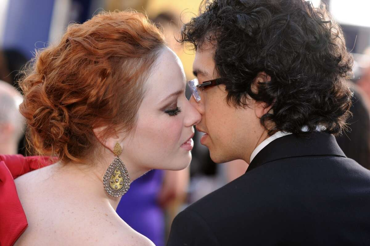 Actress Christina Hendricks and fiance Geoffrey Arend arrive to the TNT/TBS broadcast of the 16th Annual Screen Actors Guild Awards held at the Shrine Auditorium on January 23, 2010 in Los Angeles, California.